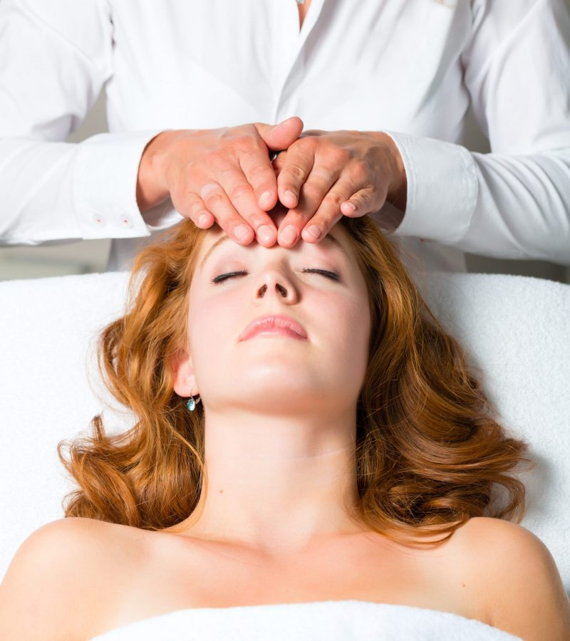 wellness-woman-getting-head-massage-in-spa-min